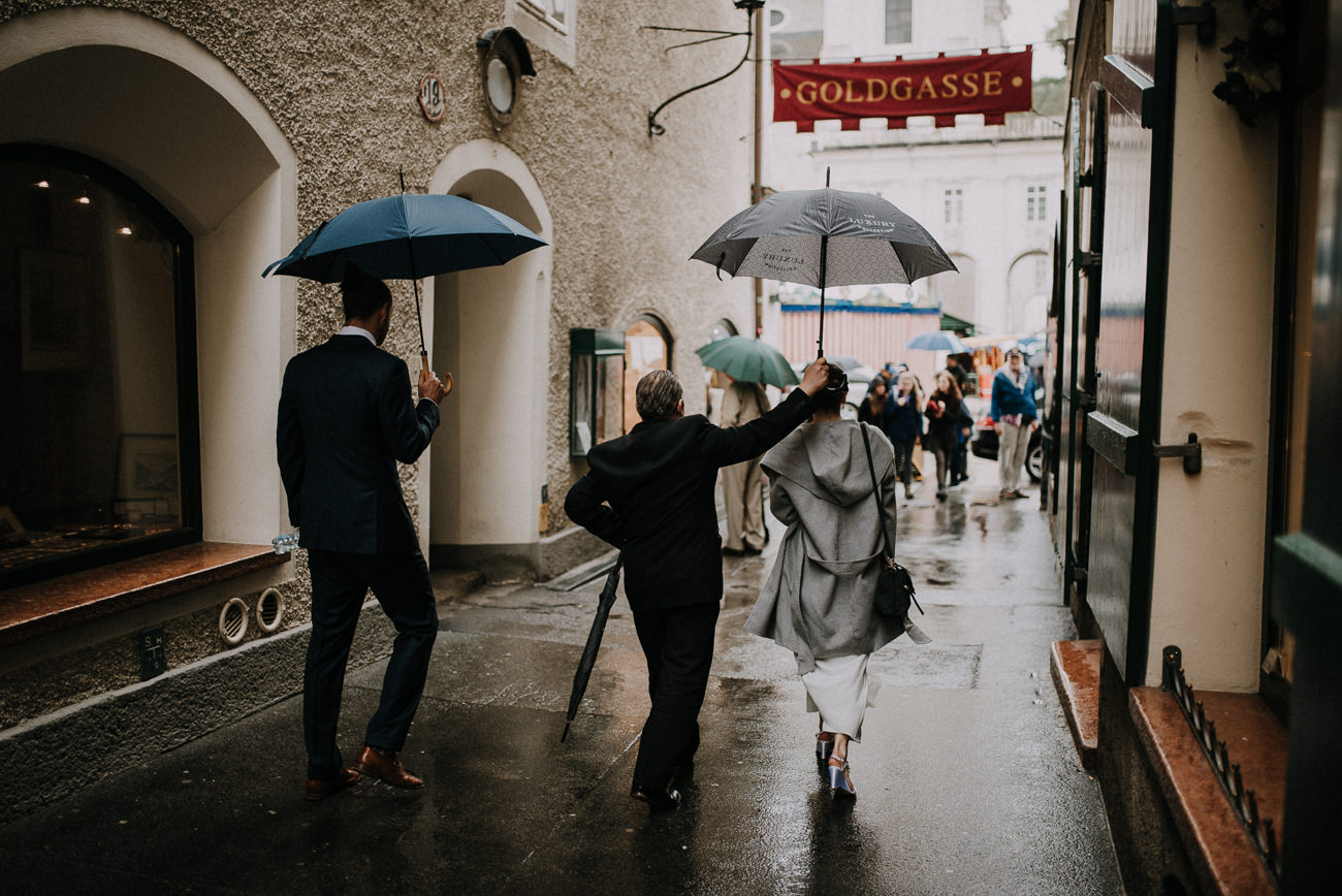bride and groom on old salzburg streets