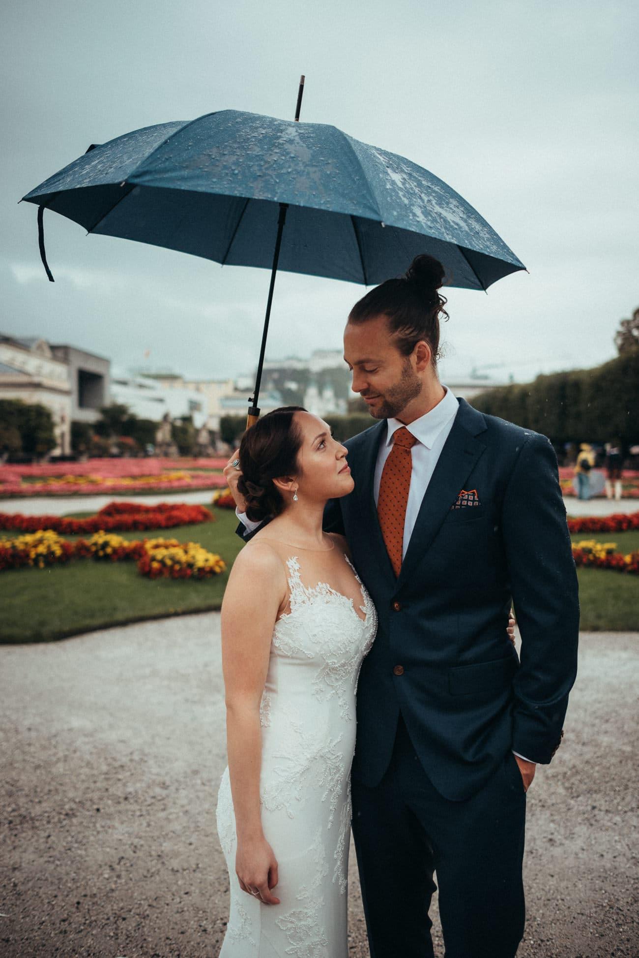 Bride and Groom in amazing flower garden in Mirabell Salzburg
