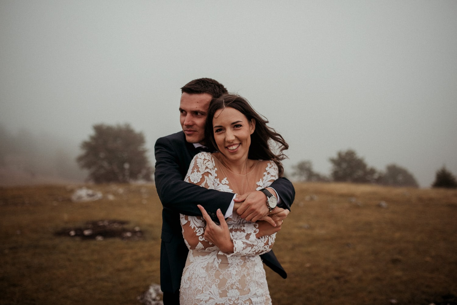 Couple in love having their wedding session on top of the mountain Vlasic