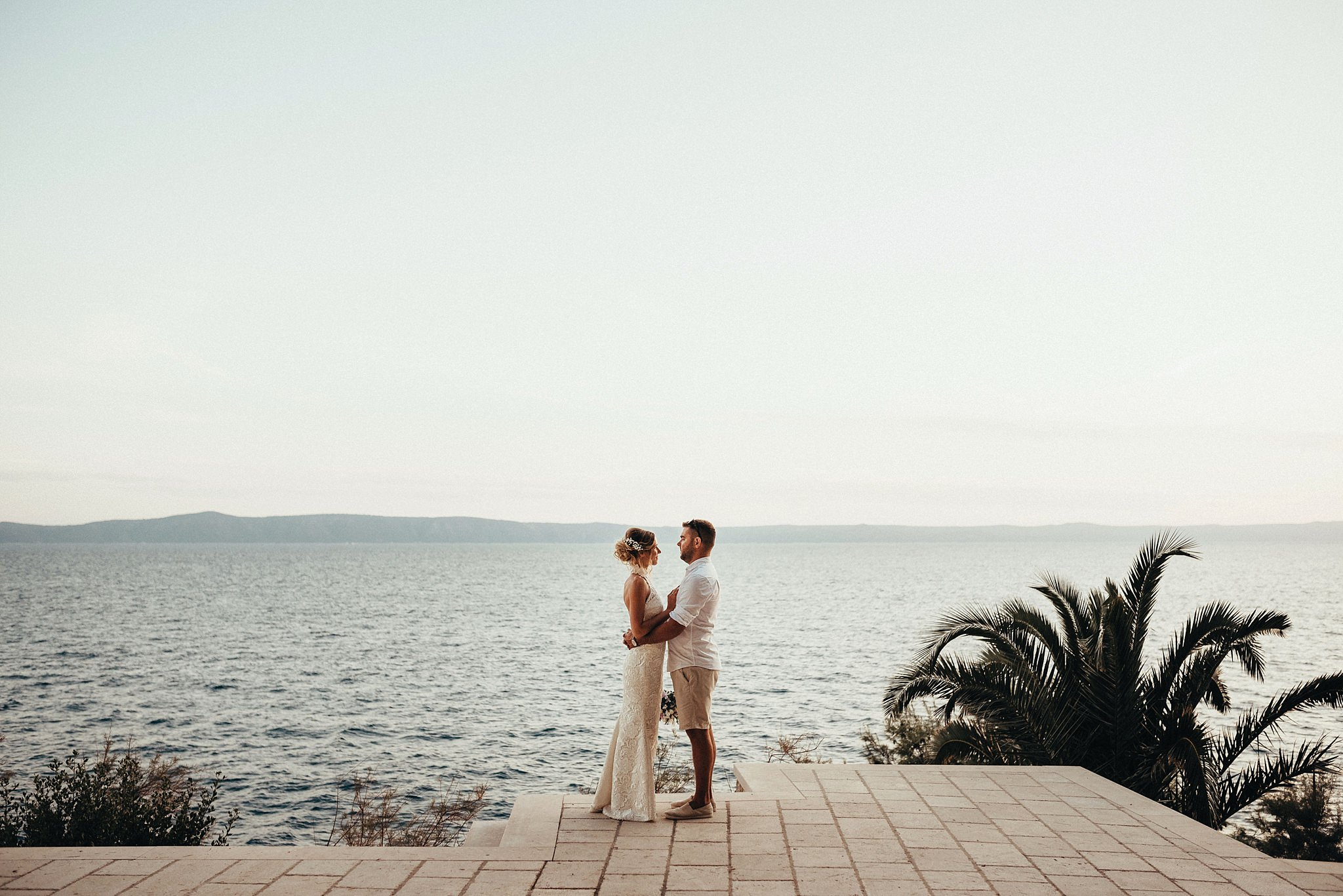 Beautiful panorama of Makarska with couple in love