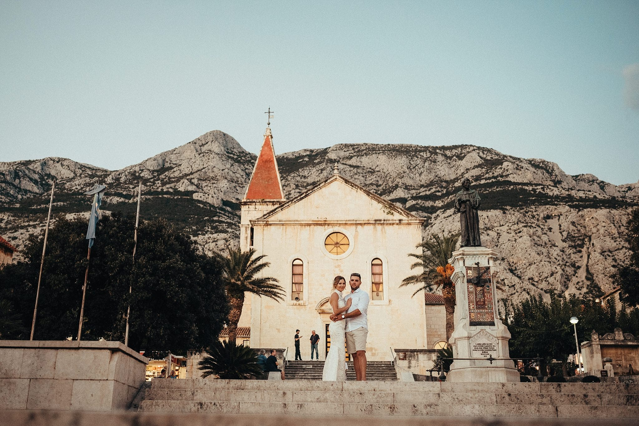Destination wedding couple from Hungary in front of Makarska Church